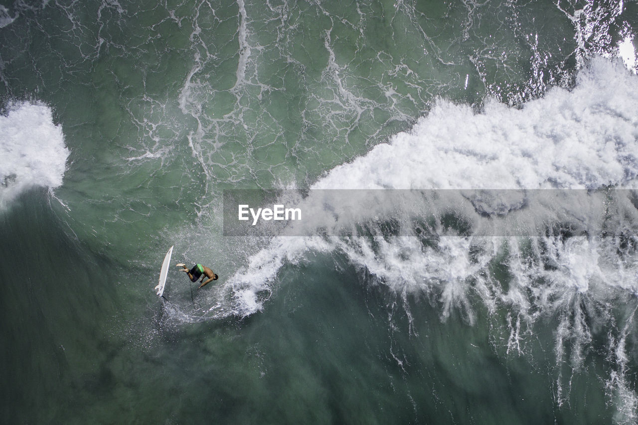 High Angle View Of Man Surfing In Sea