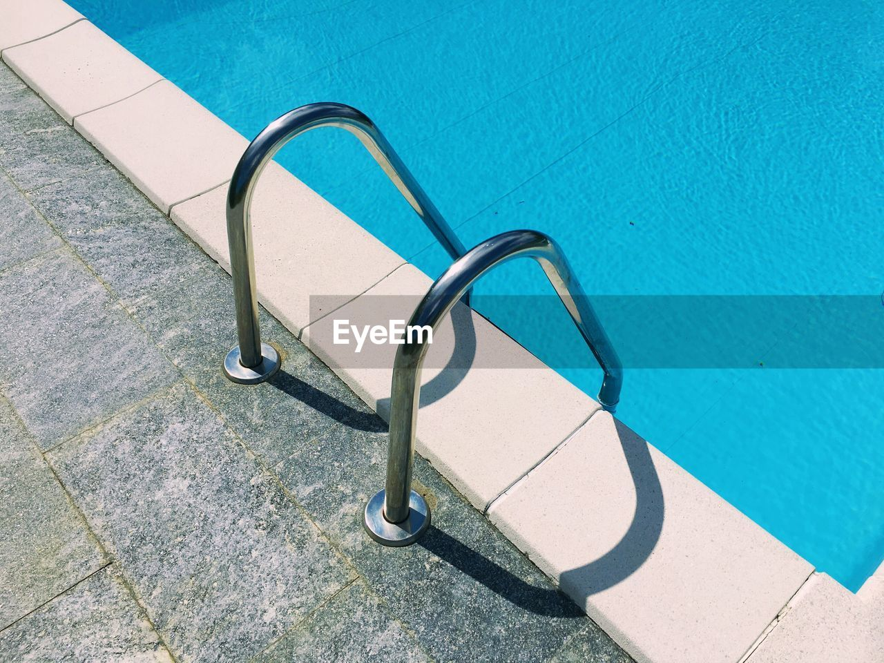 High angle view of ladder at swimming pool