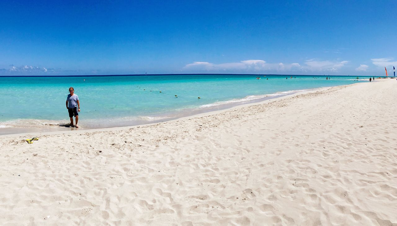 beach, sea, land, water, sky, sand, scenics - nature, beauty in nature, real people, blue, one person, horizon, horizon over water, holiday, trip, nature, vacations, leisure activity, day, turquoise colored, outdoors