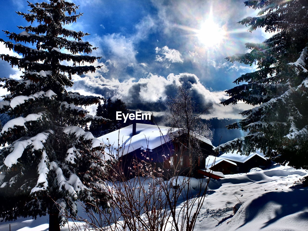 snow, winter, cold temperature, beauty in nature, nature, sunlight, weather, tranquility, tree, sunbeam, sun, scenics, tranquil scene, outdoors, day, no people, sky, mountain, landscape, snowcapped mountain