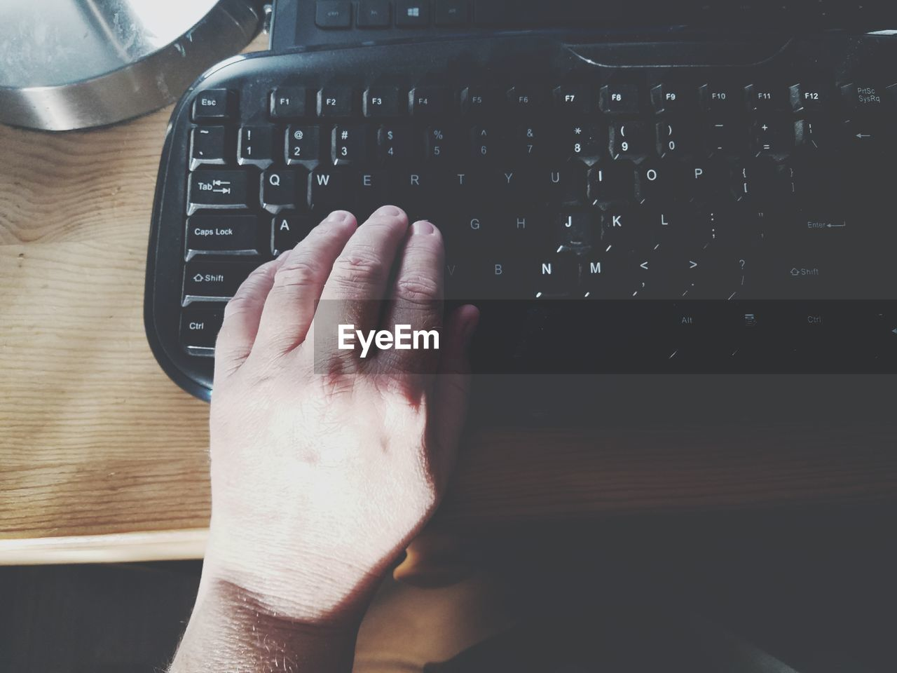 Close-Up Of Man Using Computer