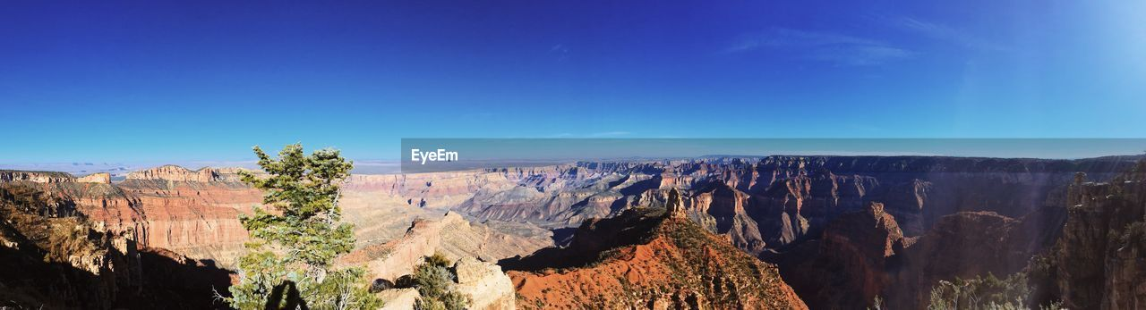 sky, mountain, nature, beauty in nature, blue, rock, environment, tranquility, scenics - nature, panoramic, travel, tranquil scene, rock formation, landscape, rock - object, non-urban scene, day, clear sky, no people, canyon, outdoors, formation
