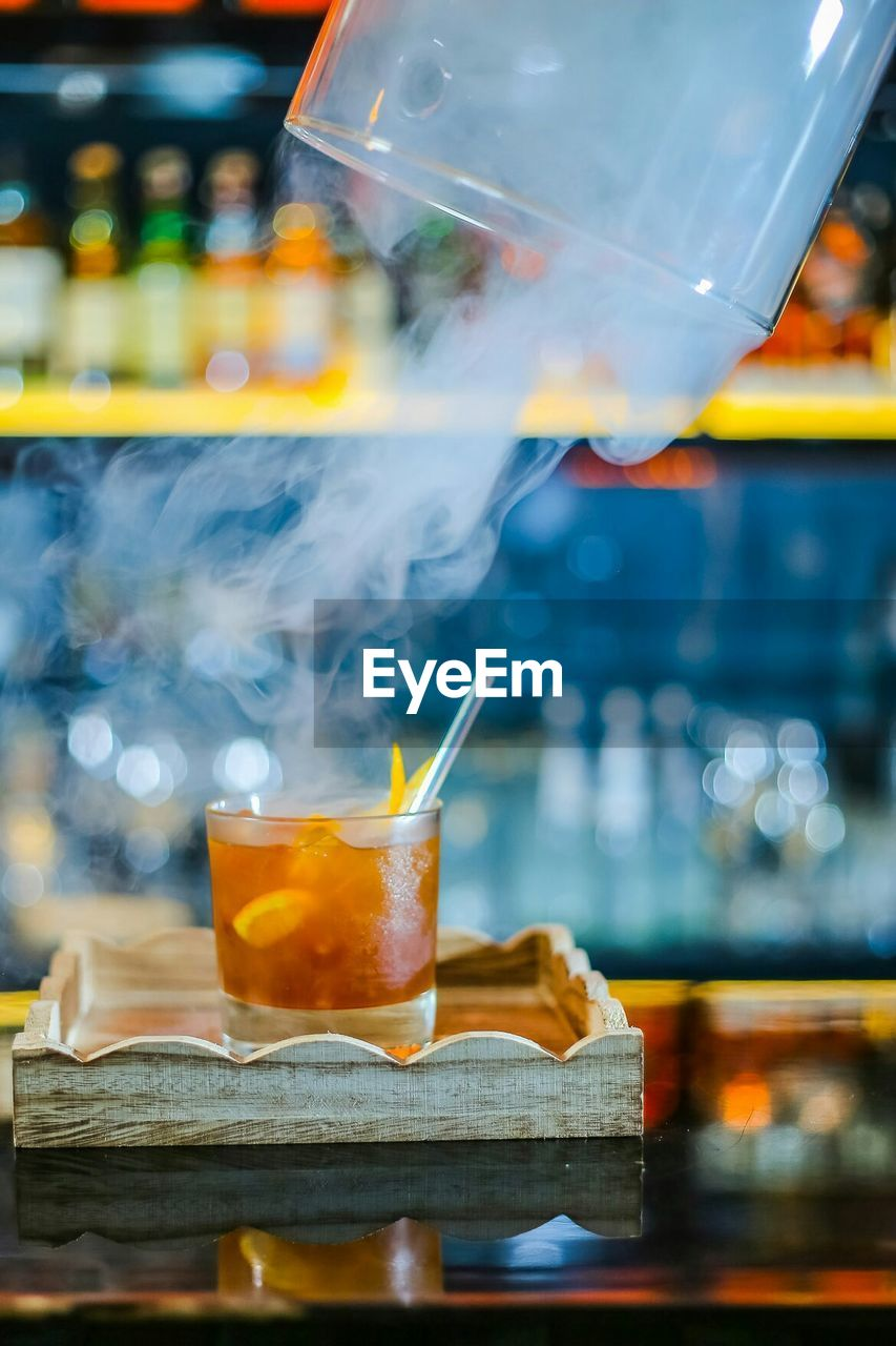 Smoke Emitting From Cocktail On Table