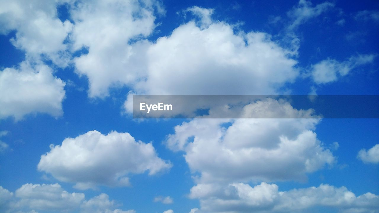 cloud - sky, beauty in nature, nature, sky, blue, backgrounds, white color, tranquility, low angle view, sky only, scenics, full frame, no people, day, outdoors, tranquil scene