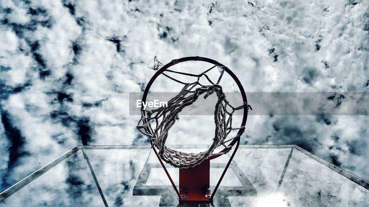 Directly Below Shot Of Basketball Hoop Against Cloudy Sky