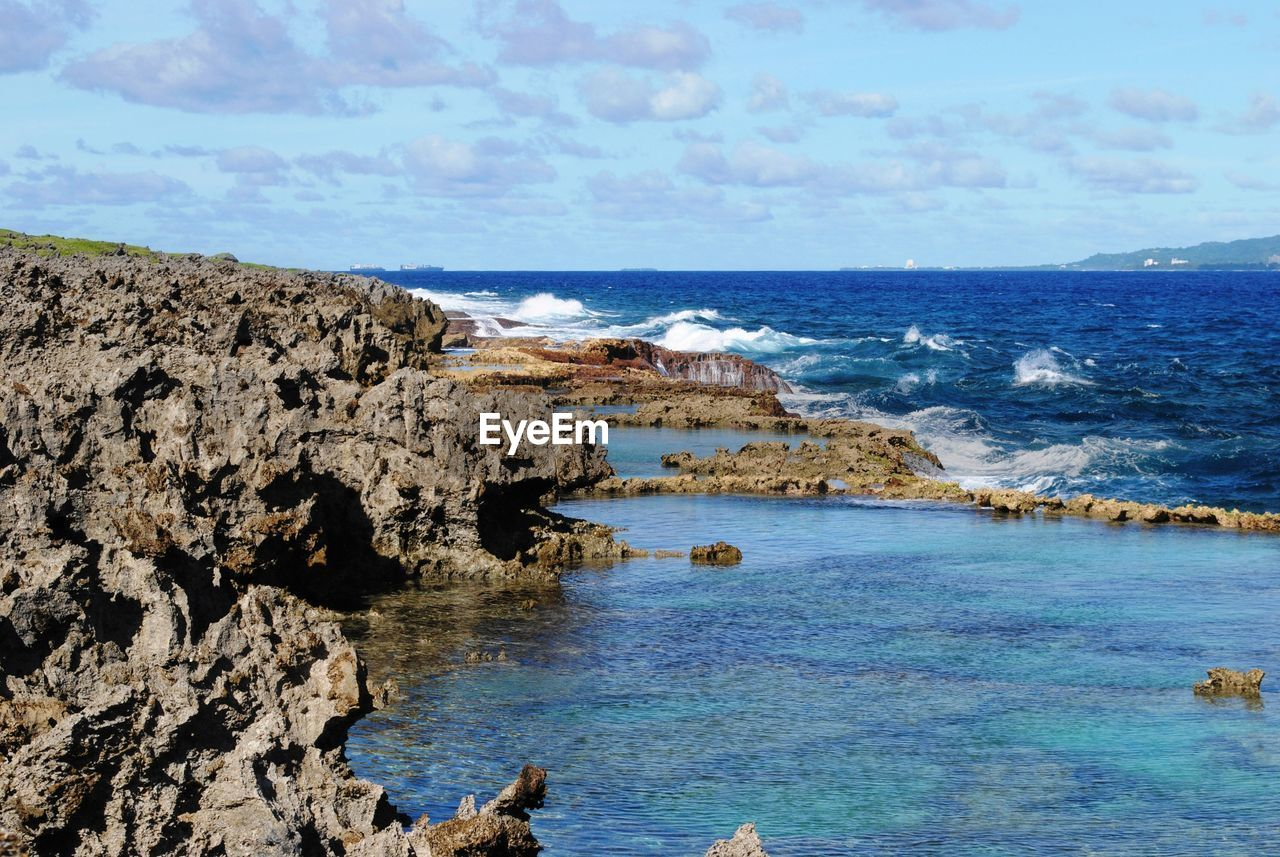 sea, water, sky, rock, scenics - nature, beauty in nature, rock - object, horizon over water, horizon, rock formation, land, solid, beach, nature, tranquil scene, day, tranquility, cloud - sky, no people, outdoors, rocky coastline