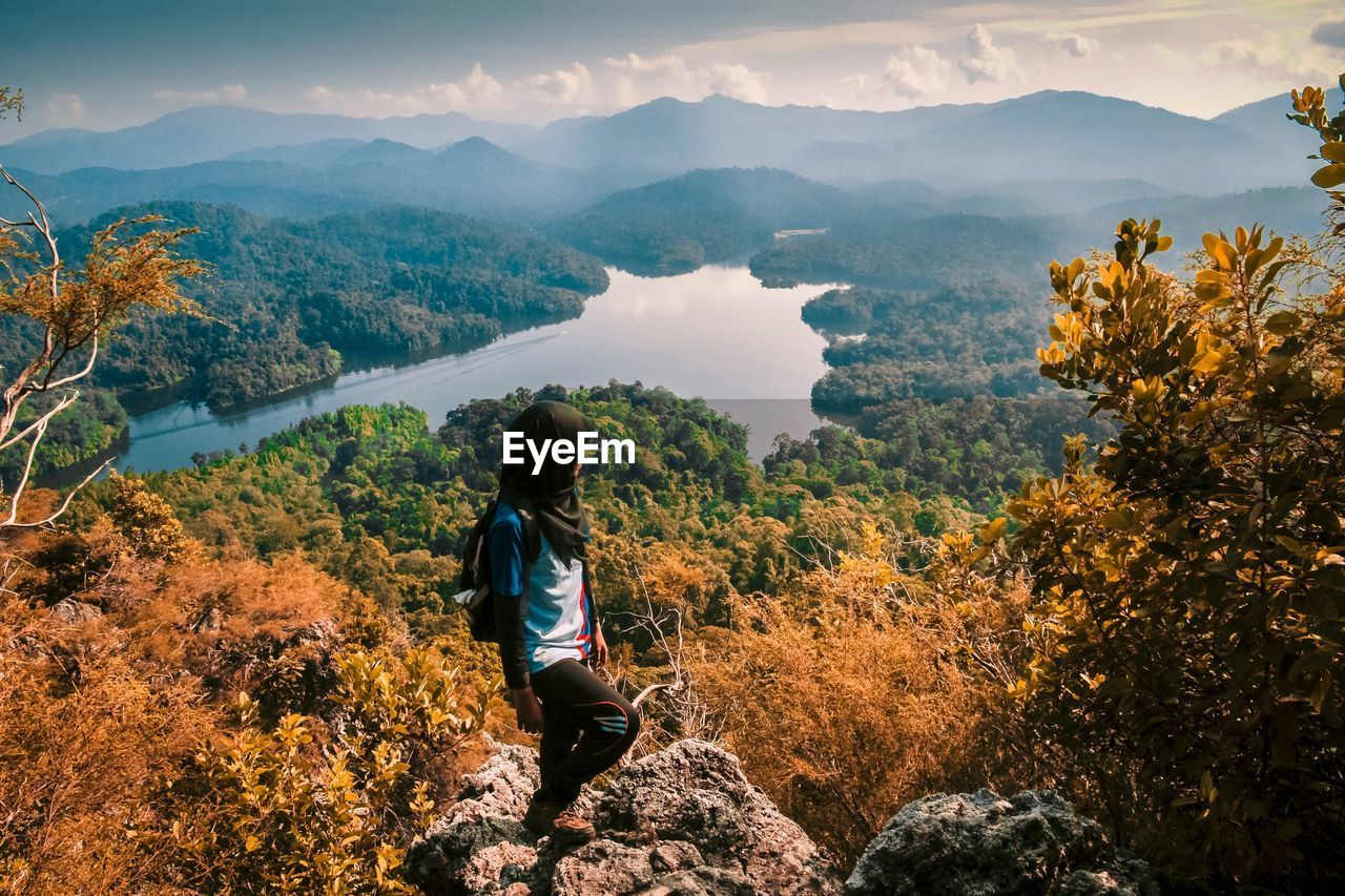 High Angle View Of Woman Standing On Mountain