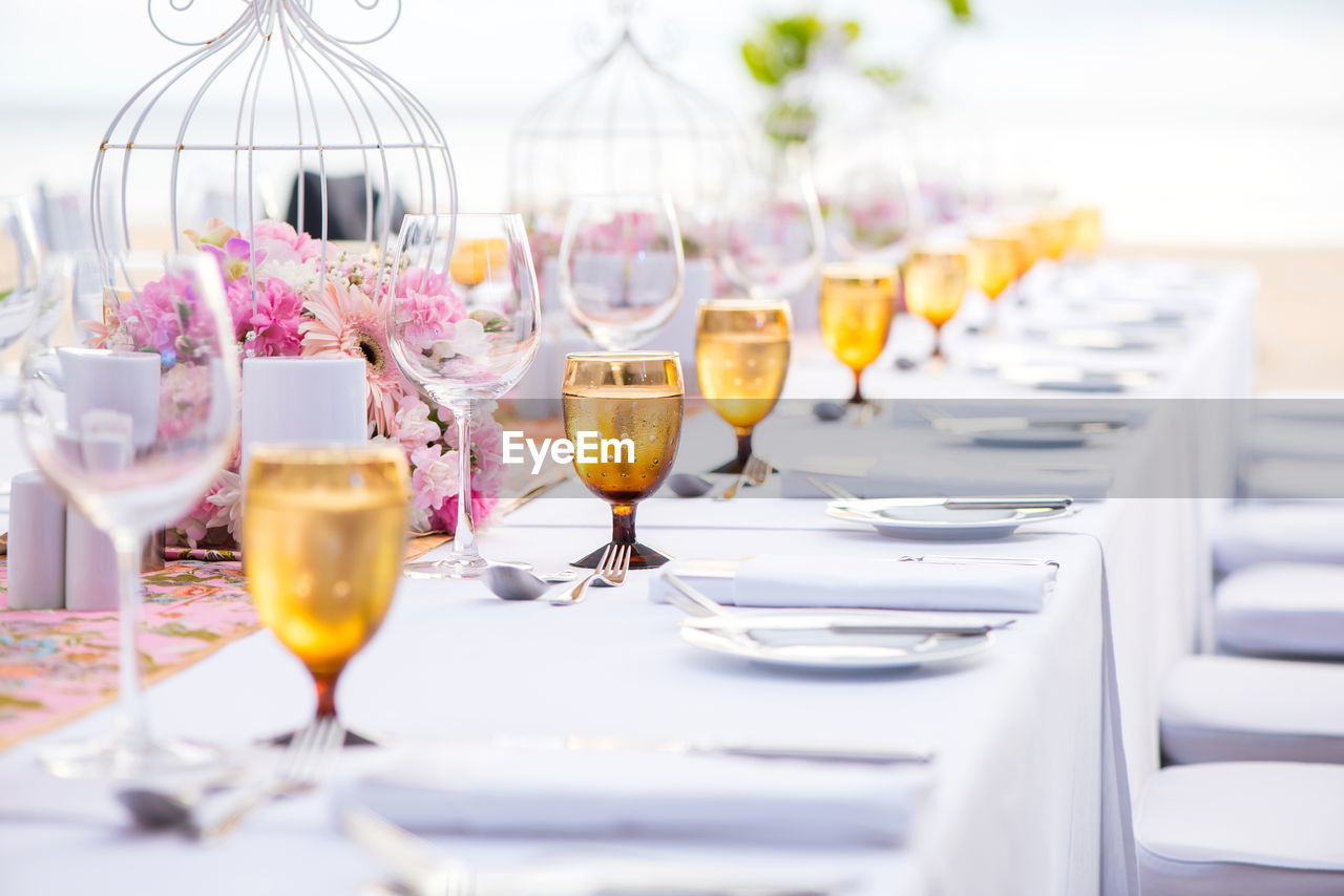 glass, wineglass, food and drink, table, refreshment, drink, household equipment, drinking glass, freshness, alcohol, arrangement, wine, no people, setting, in a row, place setting, glass - material, business, restaurant, indoors, order, luxury