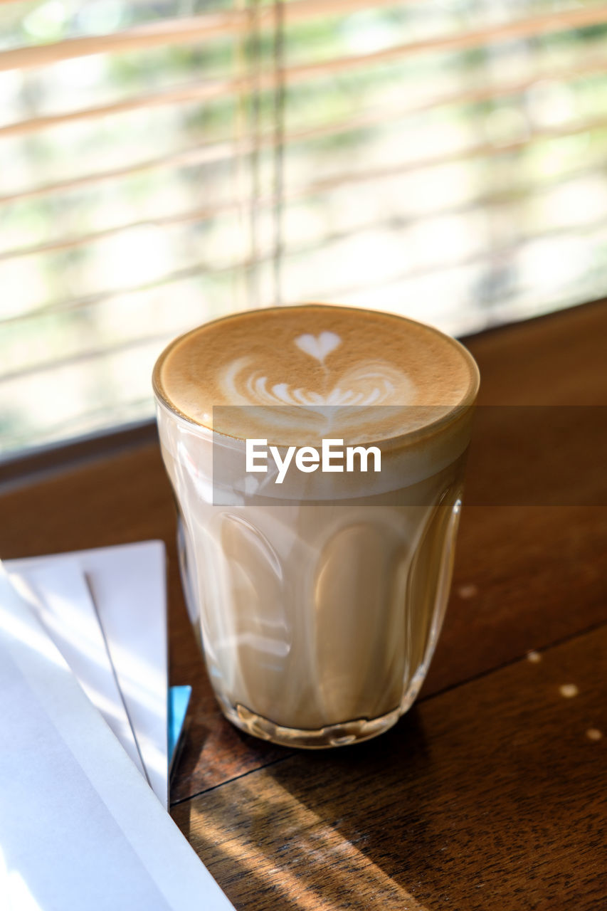 refreshment, drink, coffee, table, coffee - drink, food and drink, coffee cup, frothy drink, froth art, still life, cup, mug, cappuccino, focus on foreground, indoors, no people, close-up, freshness, hot drink, latte, glass, crockery, non-alcoholic beverage