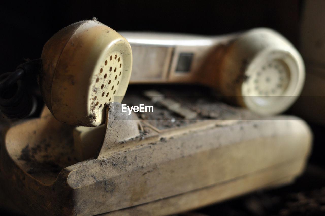 Close-up of abandoned telephone