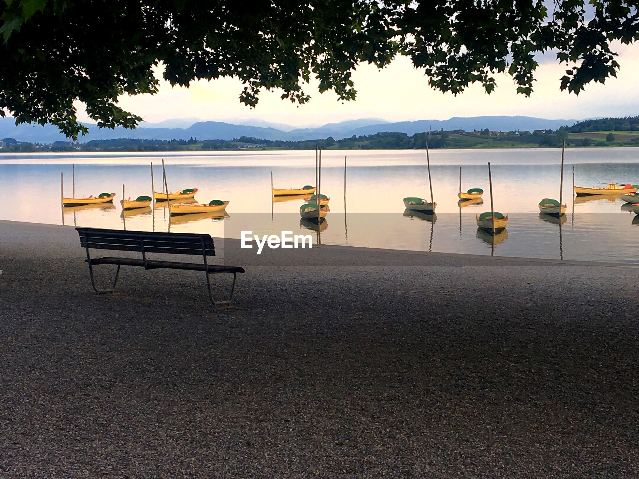 CHAIRS AND TABLE IN LAKE