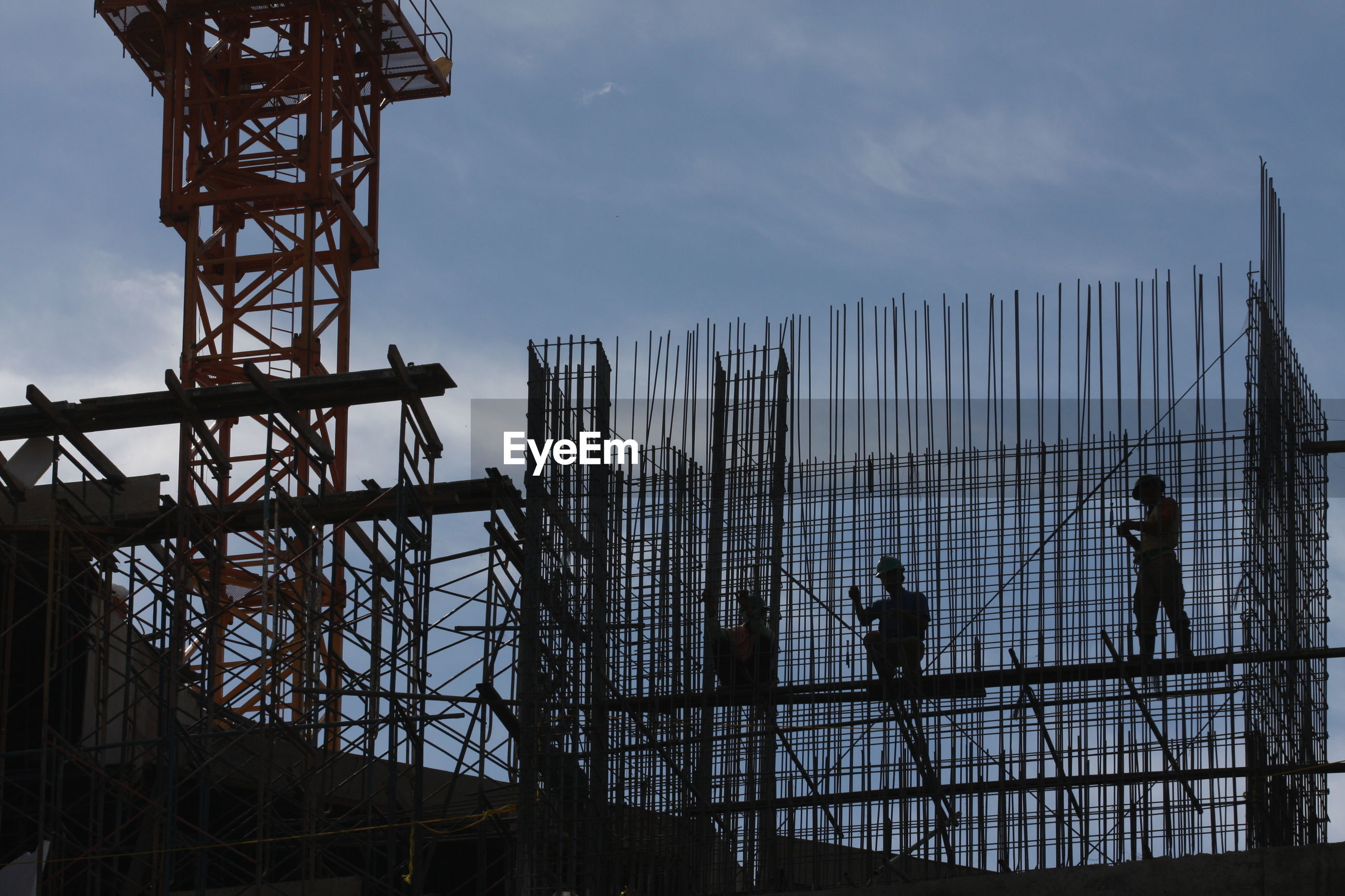 Low angle view of men on construction site