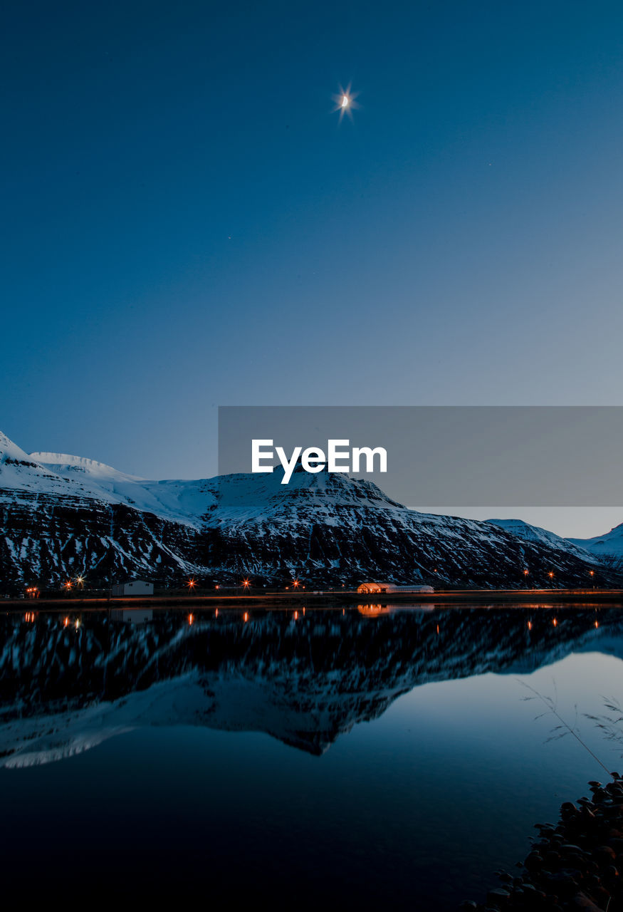 sky, mountain, reflection, water, scenics - nature, beauty in nature, tranquility, tranquil scene, winter, snow, cold temperature, blue, nature, lake, mountain range, no people, snowcapped mountain, clear sky, waterfront, mountain peak