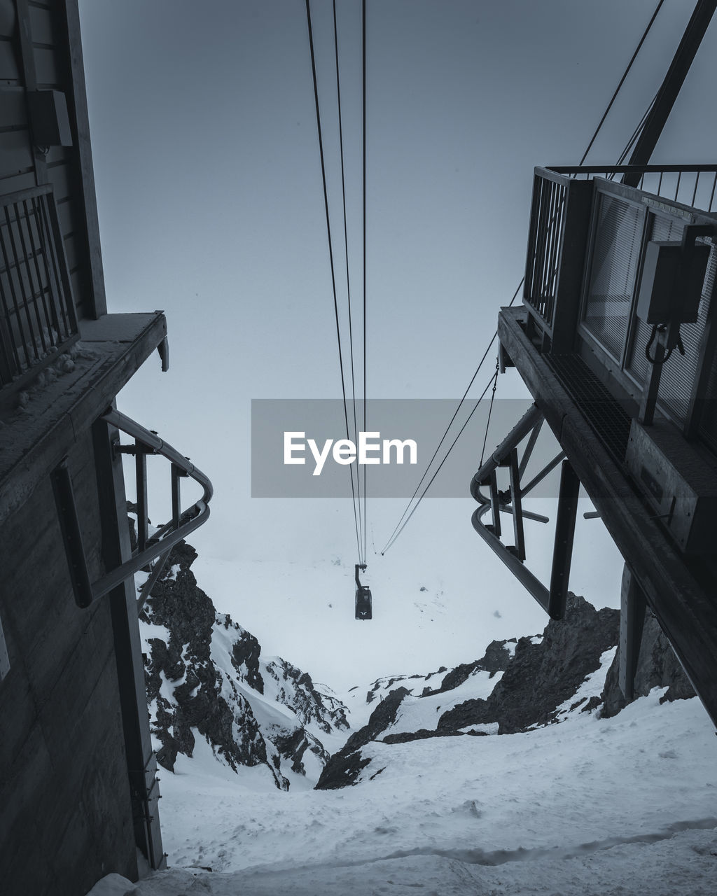 snow, cold temperature, winter, nature, sky, beauty in nature, mountain, architecture, built structure, day, scenics - nature, cable car, covering, white color, ski lift, cable, clear sky, snowcapped mountain, no people, outdoors