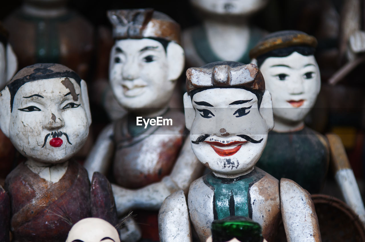 Close-up of wooden puppets for sale at market stall