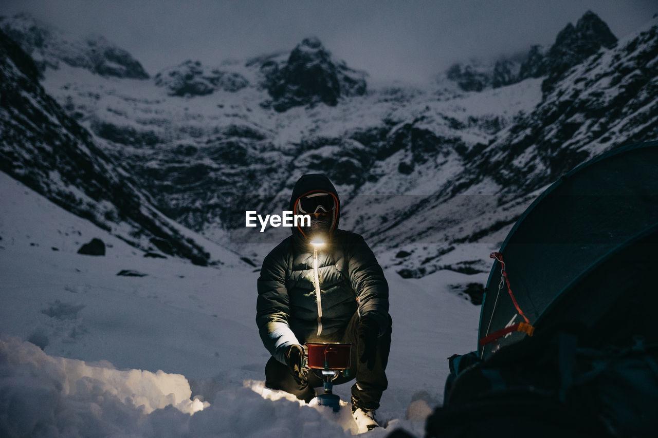 MAN SKIING ON SNOWCAPPED MOUNTAINS