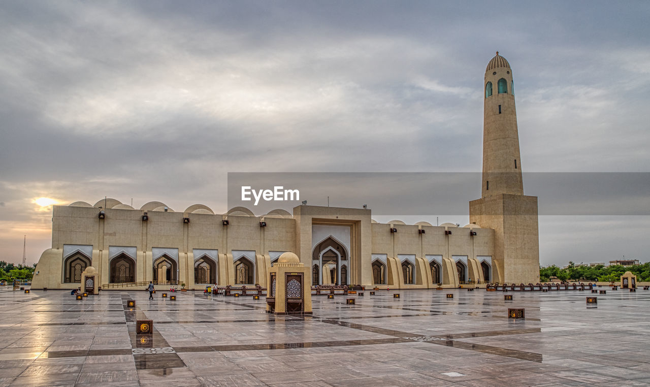 architecture, built structure, sky, history, building exterior, the past, cloud - sky, travel destinations, arch, incidental people, tourism, religion, building, place of worship, belief, travel, nature, spirituality, group of people, day, outdoors, architectural column
