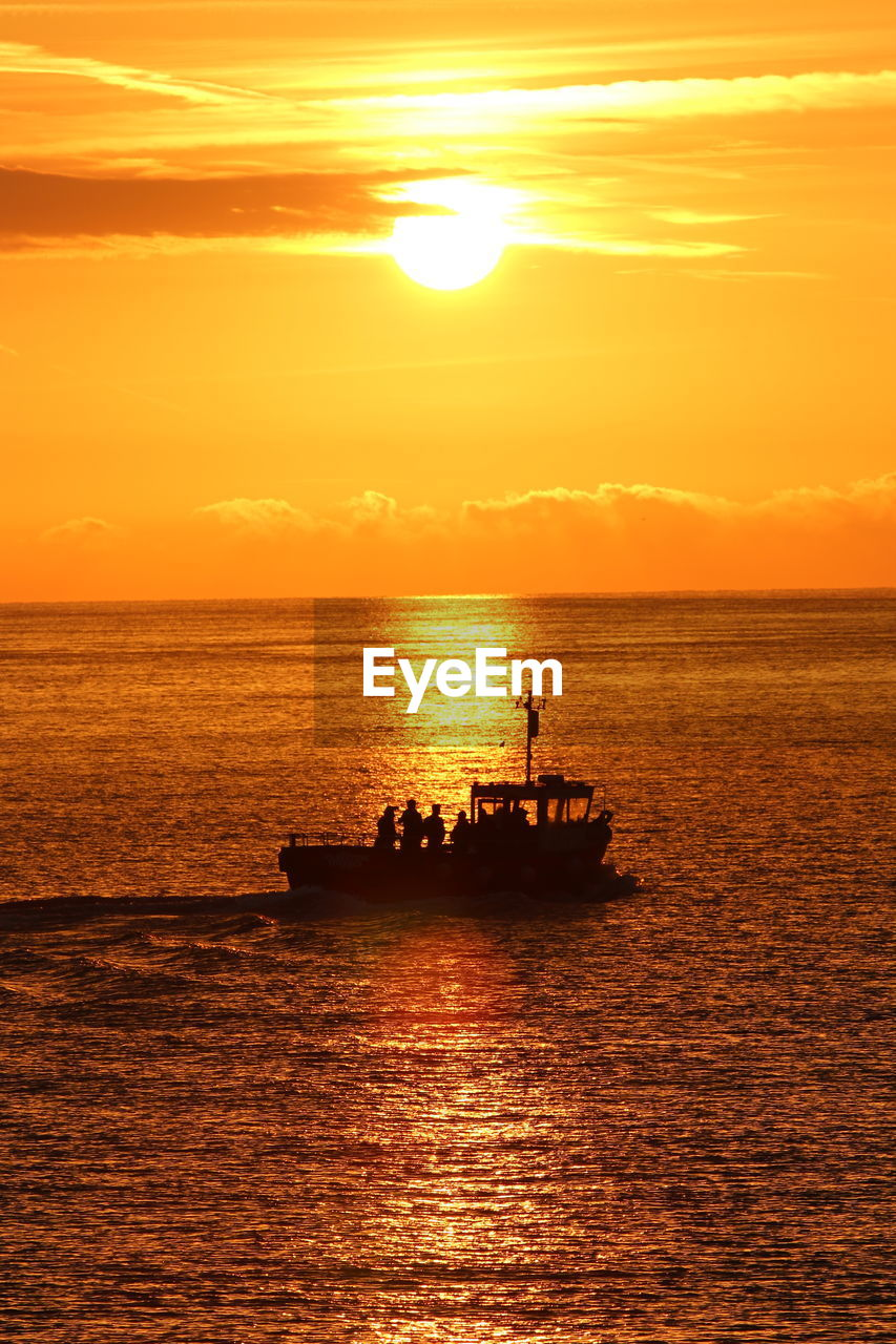 sunset, sky, water, sea, nautical vessel, orange color, scenics - nature, transportation, beauty in nature, silhouette, mode of transportation, waterfront, horizon over water, tranquil scene, tranquility, sun, idyllic, horizon, nature, outdoors