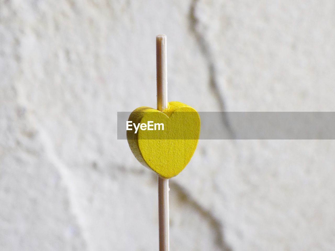 yellow, close-up, heart shape, still life, indoors, no people, focus on foreground, sweet food, sweet, emotion, positive emotion, love, selective focus, day, food, freshness, unhealthy eating, food and drink, shape, lollipop, temptation