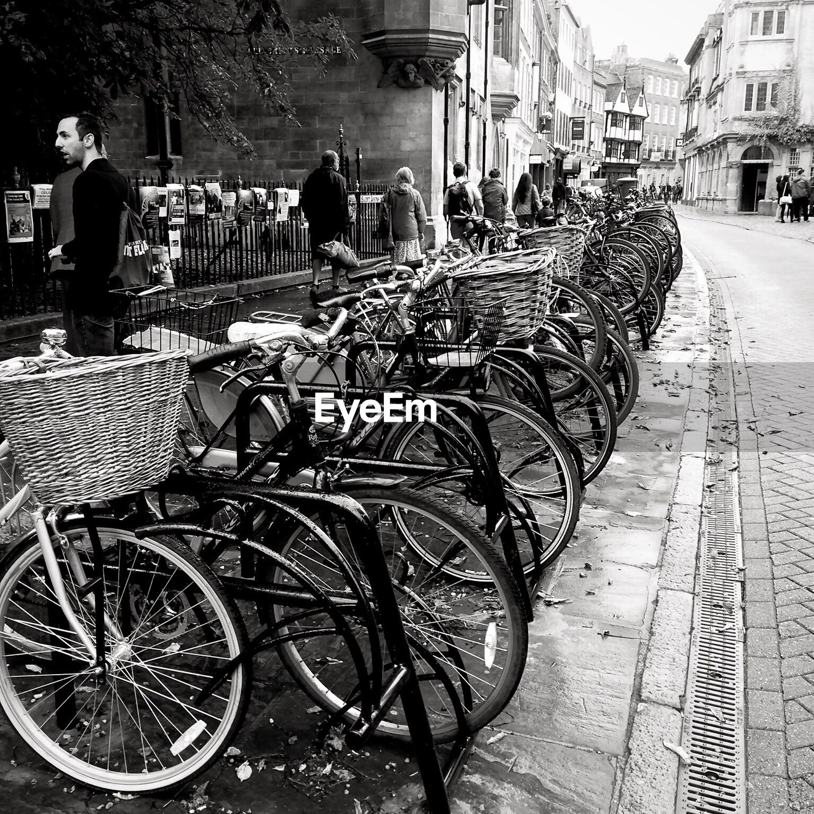 Bicycles parked by street in city