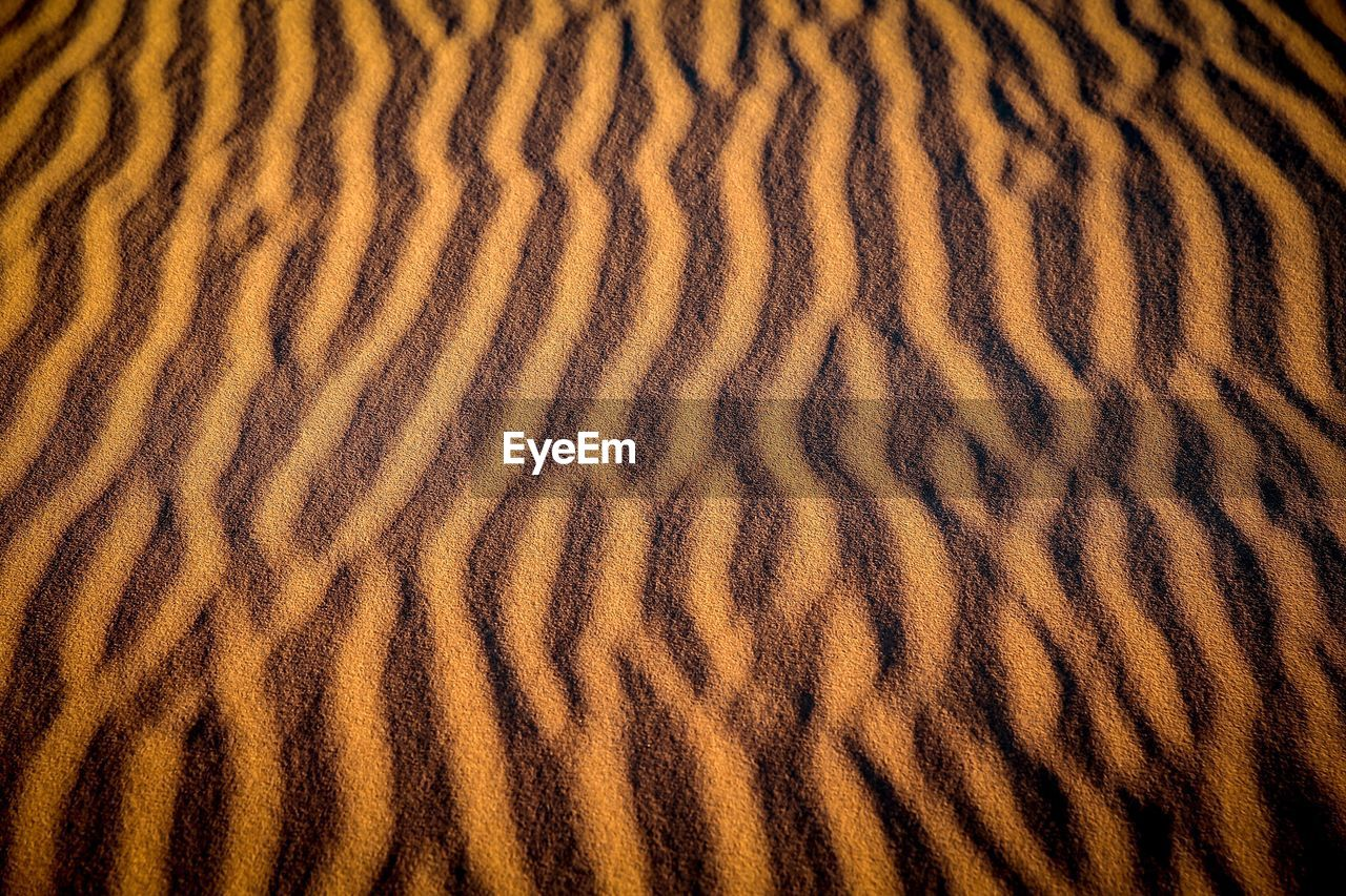 pattern, natural pattern, full frame, backgrounds, wave pattern, no people, desert, textured, brown, land, sand, nature, rippled, climate, beauty in nature, scenics - nature, landscape, close-up, sand dune, tranquility, arid climate