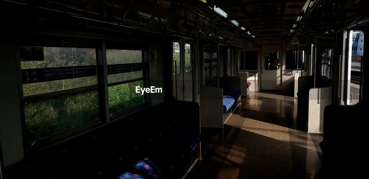 window, public transportation, rail transportation, indoors, train, one person, architecture, transportation, mode of transportation, day, train - vehicle, transparent, glass - material, travel, real people, seat, passenger train, men