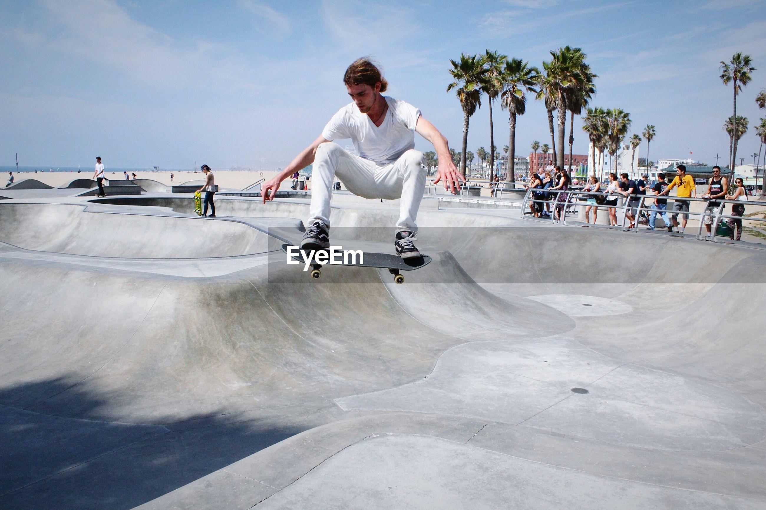 WOMAN JUMPING ON SKATEBOARD