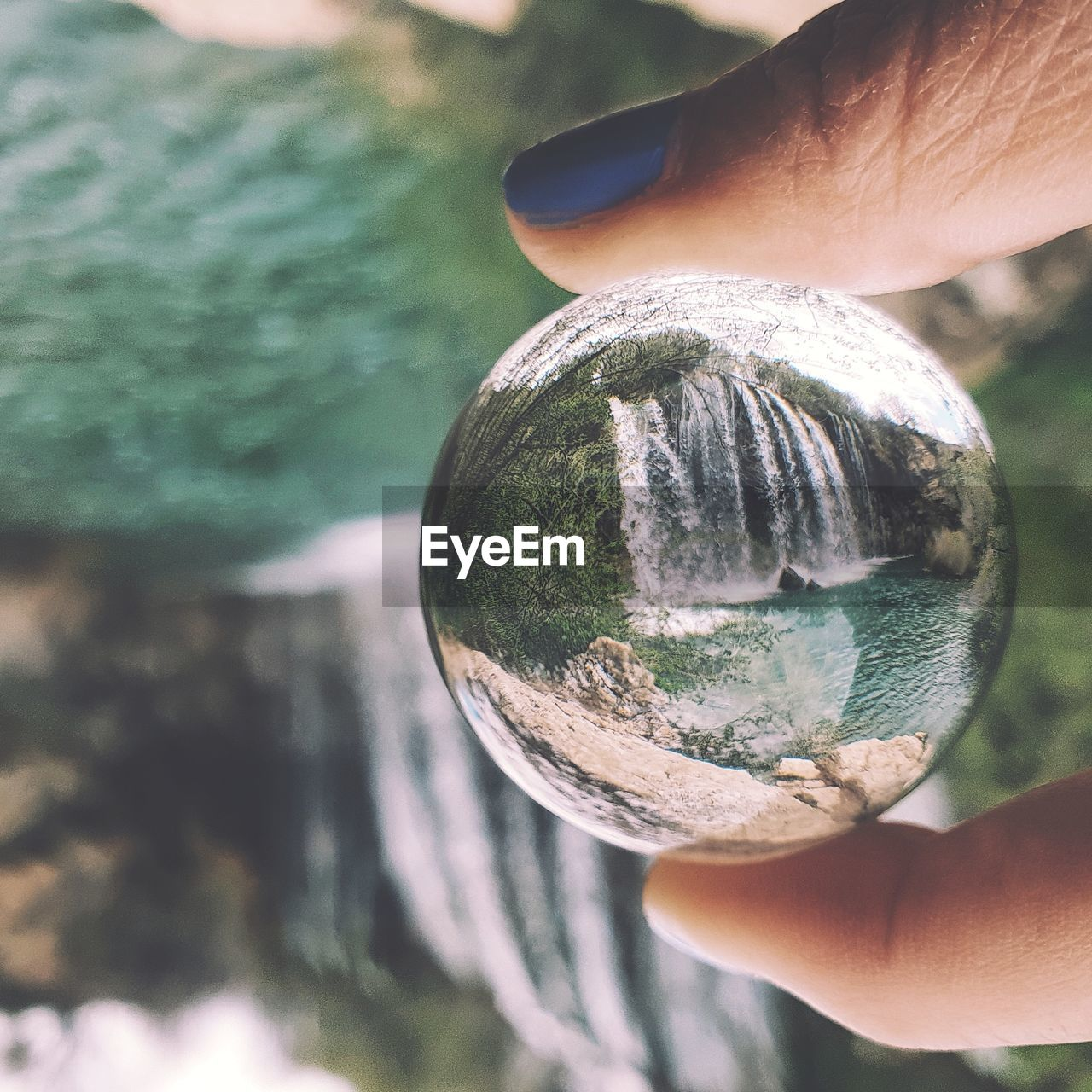 Close-up of woman hand holding crystal ball