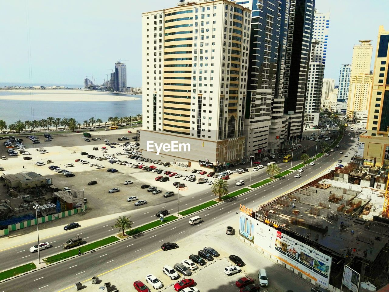 city, architecture, building exterior, skyscraper, high angle view, built structure, land vehicle, car, transportation, street, road, mode of transport, city life, outdoors, day, cityscape, downtown district, urban skyline, modern, tree, no people, sky