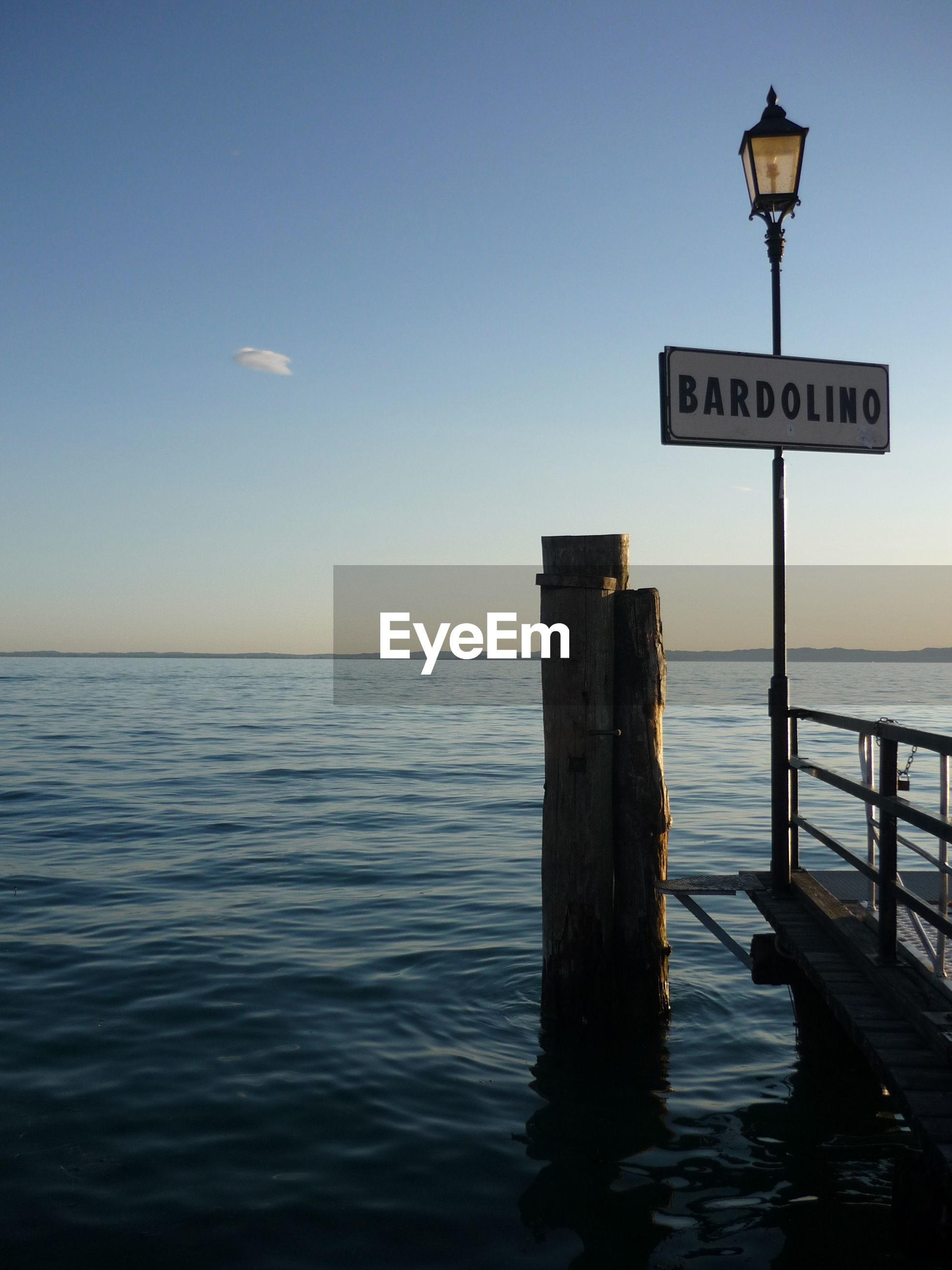 SIGN ON SEA AGAINST SKY
