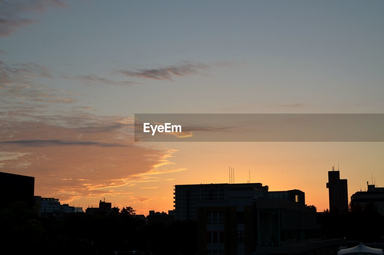 architecture, sunset, building exterior, built structure, sky, building, city, cloud - sky, orange color, silhouette, nature, no people, residential district, outdoors, beauty in nature, cityscape, scenics - nature, sunlight, city life, copy space, romantic sky