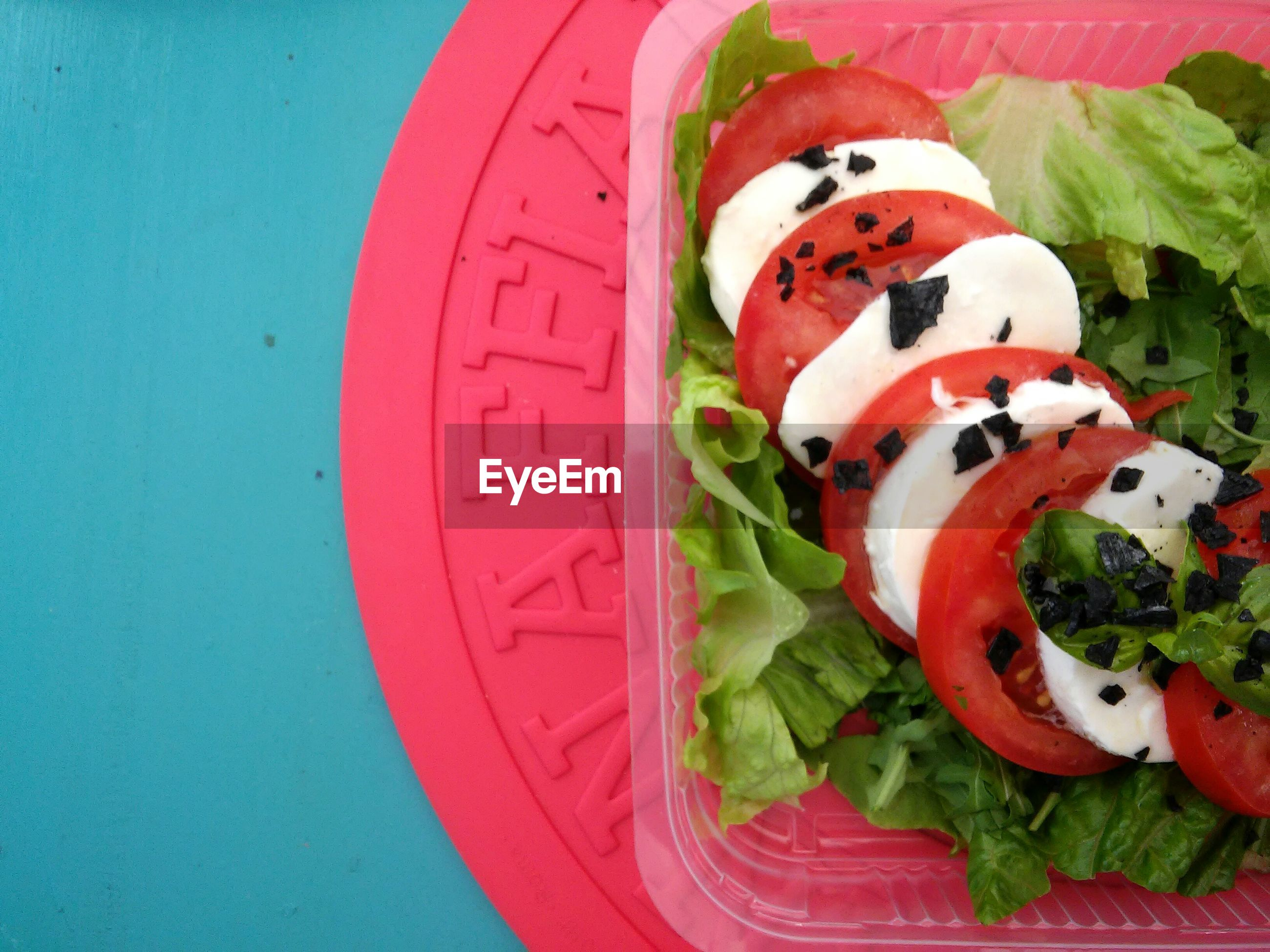 Directly above shot of salad in box on table