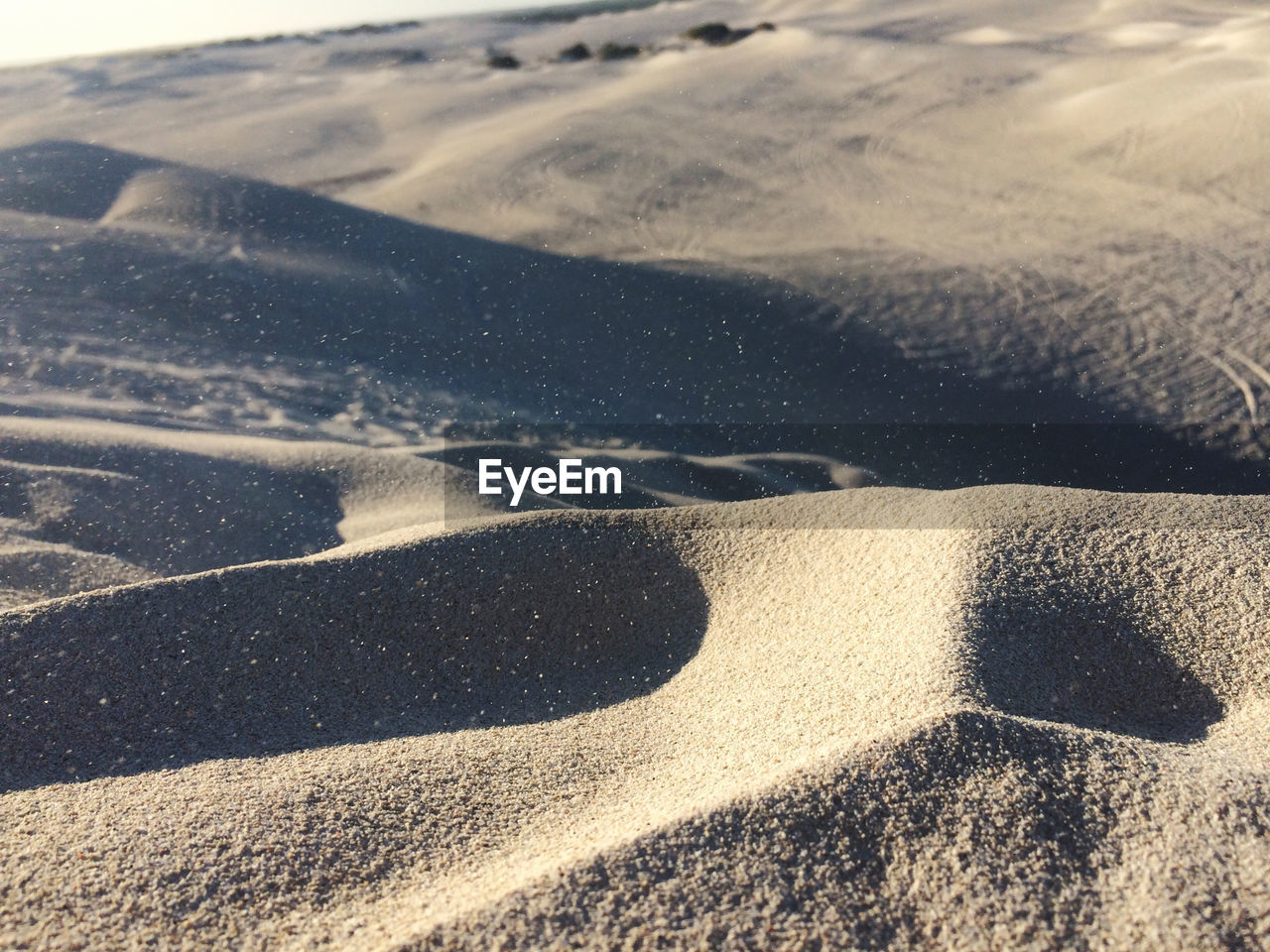 land, nature, sand, sunlight, no people, day, landscape, beach, tranquility, outdoors, high angle view, tranquil scene, shadow, desert, backgrounds, pattern, scenics - nature, full frame, beauty in nature, close-up, arid climate