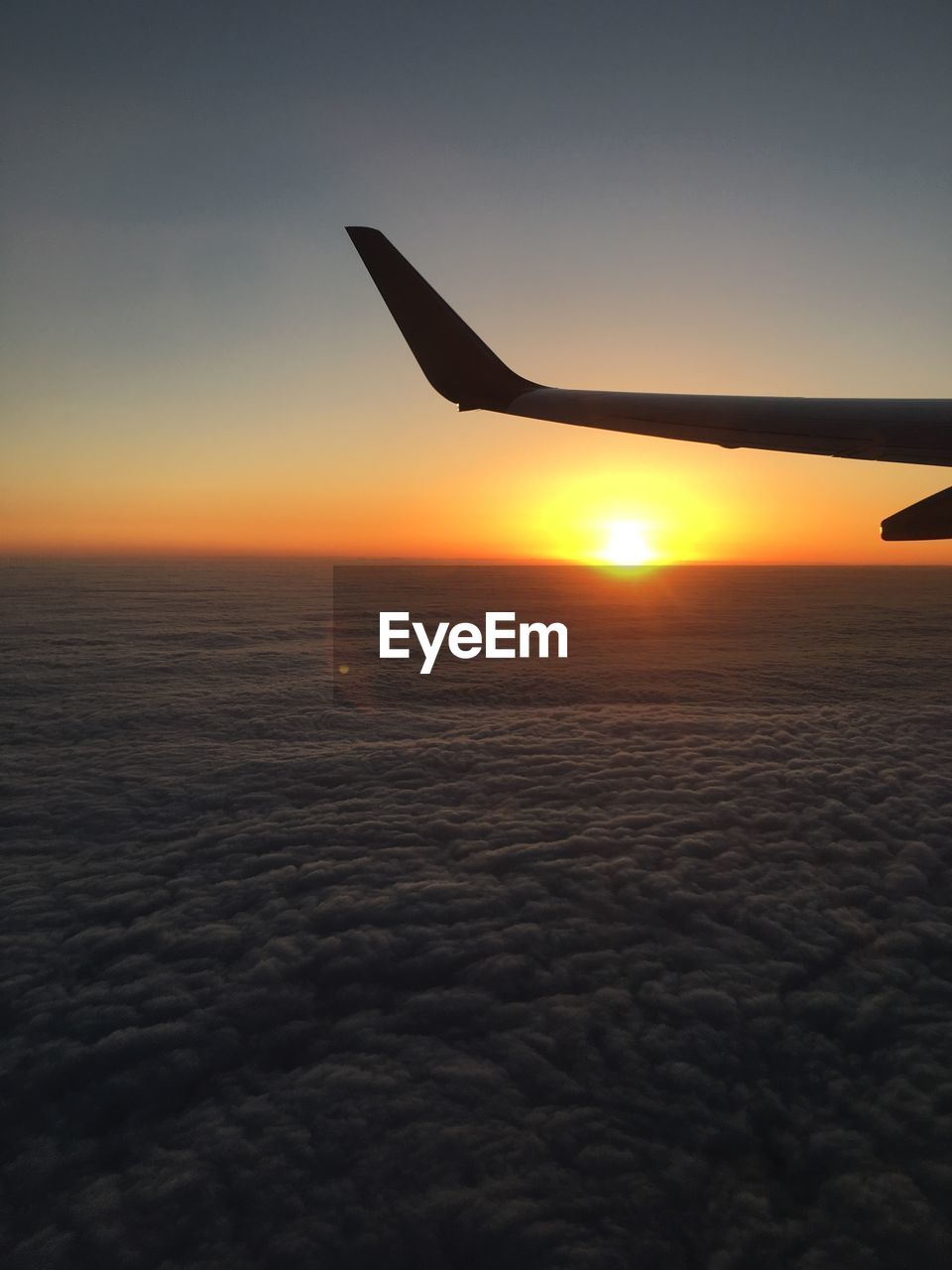 sky, sunset, air vehicle, airplane, scenics - nature, flying, beauty in nature, mid-air, mode of transportation, aircraft wing, transportation, nature, sun, cloud - sky, no people, travel, silhouette, outdoors, tranquil scene, journey