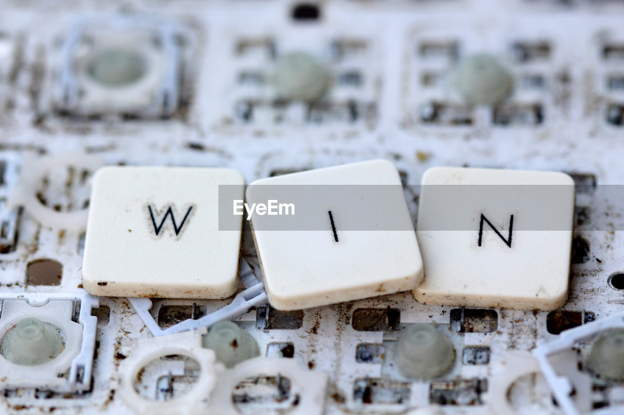 text, communication, white color, western script, no people, letter, indoors, technology, alphabet, capital letter, close-up, still life, number, snow, connection, selective focus, side by side, focus on foreground, cold temperature, block