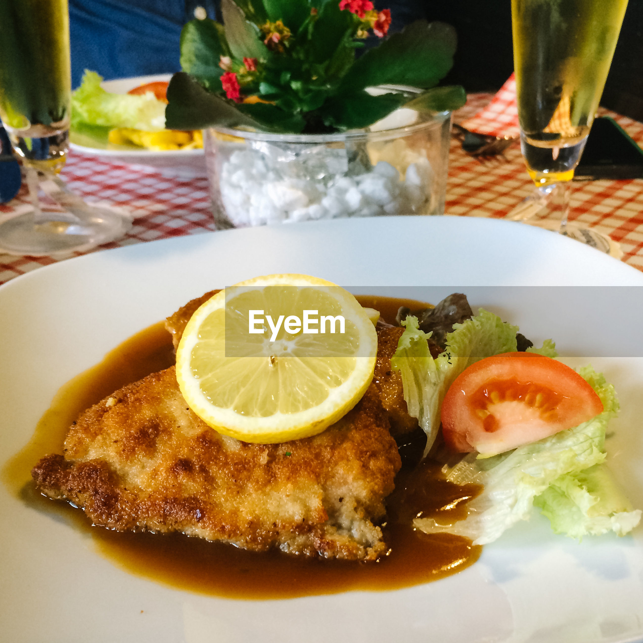 Close-up of schnitzel served in plate on restaurant table