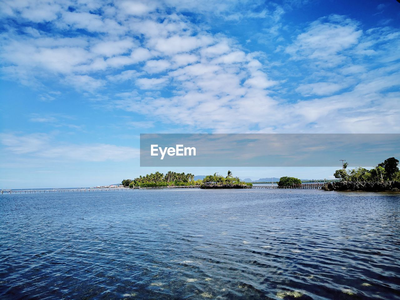 water, sky, cloud - sky, scenics - nature, beauty in nature, tranquility, tranquil scene, tree, waterfront, no people, nature, sea, blue, day, plant, idyllic, non-urban scene, outdoors