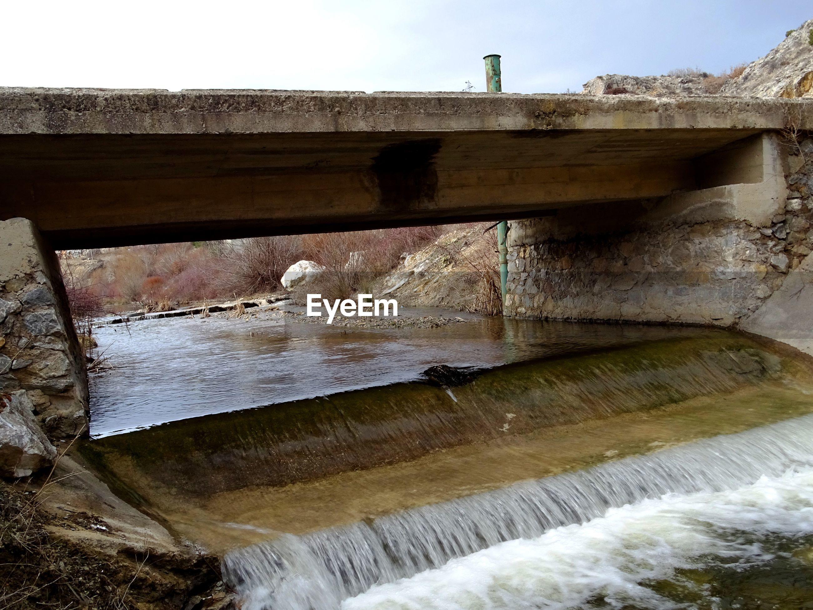 Bridge over flowing lake