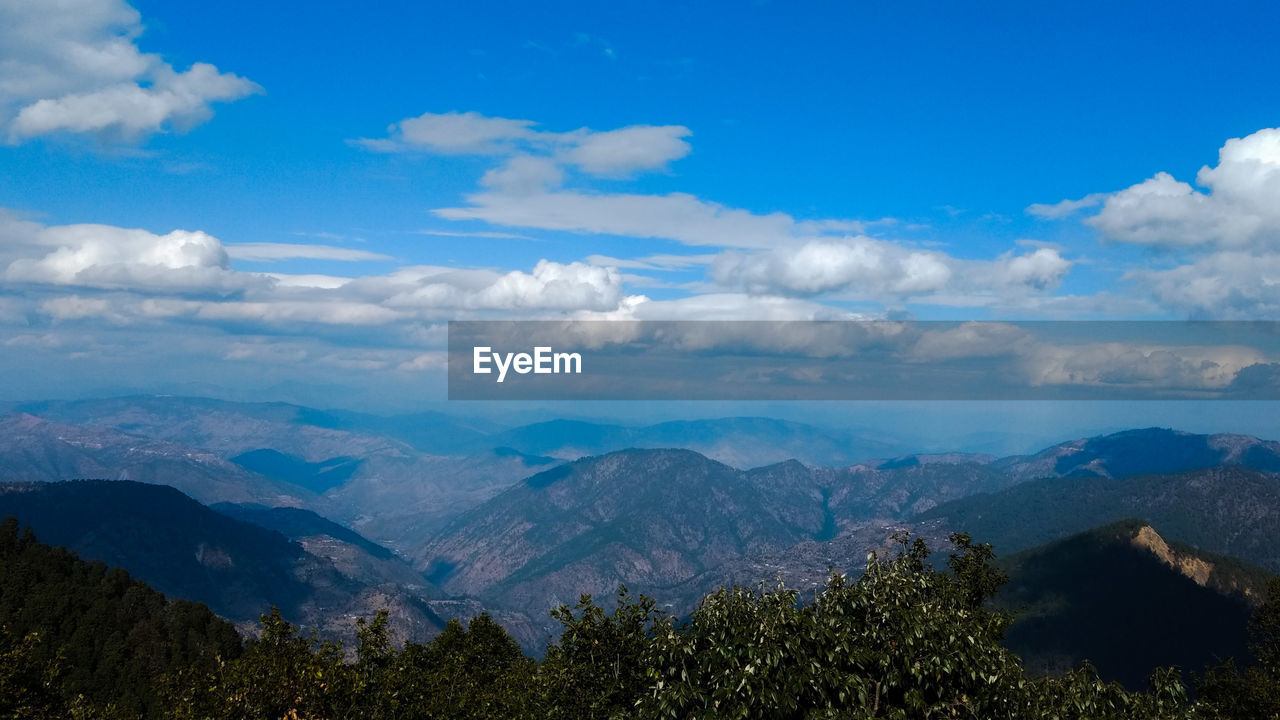 cloud - sky, scenics - nature, sky, beauty in nature, mountain, tranquil scene, tranquility, environment, landscape, tree, plant, mountain range, nature, idyllic, non-urban scene, day, no people, blue, outdoors, remote