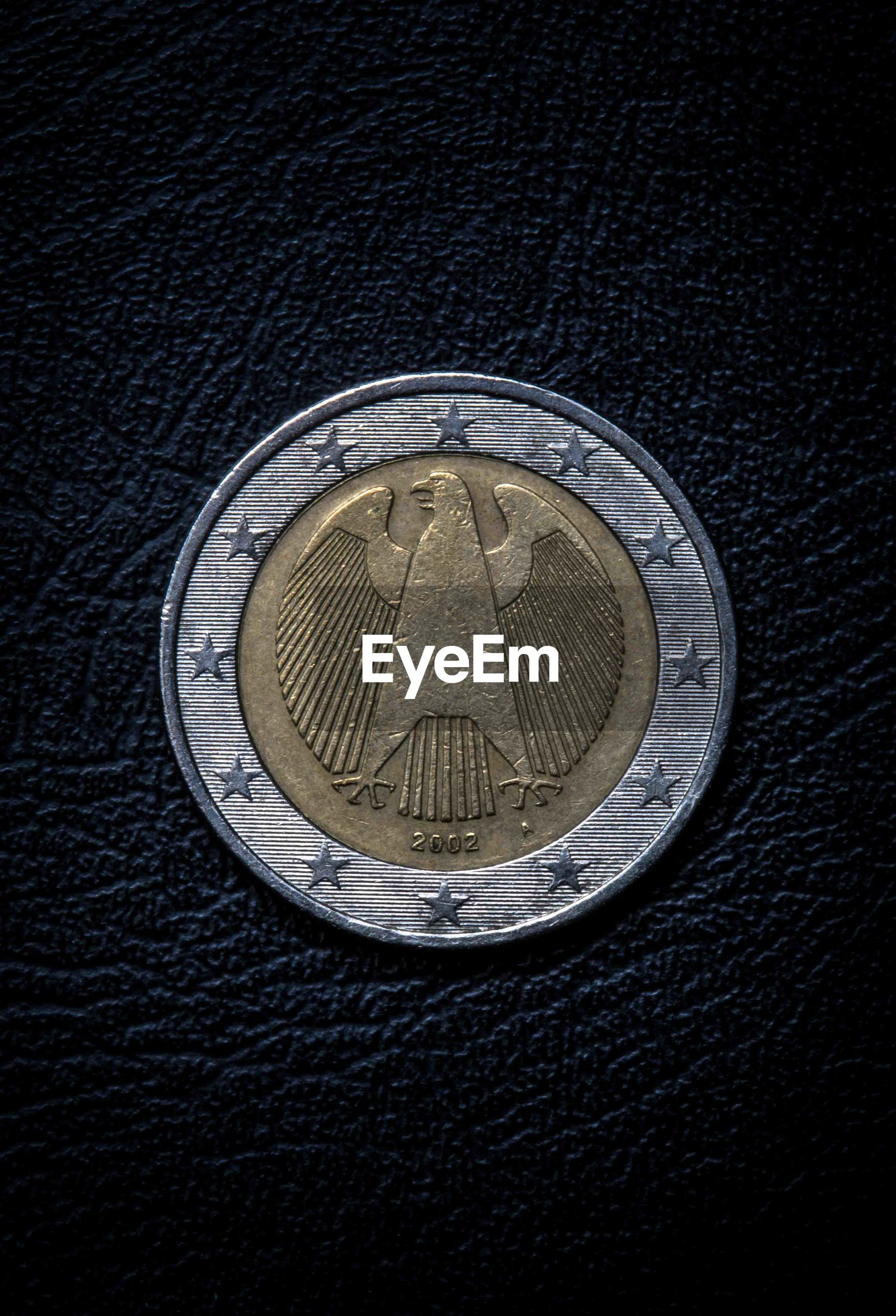 Directly above shot of coin on table