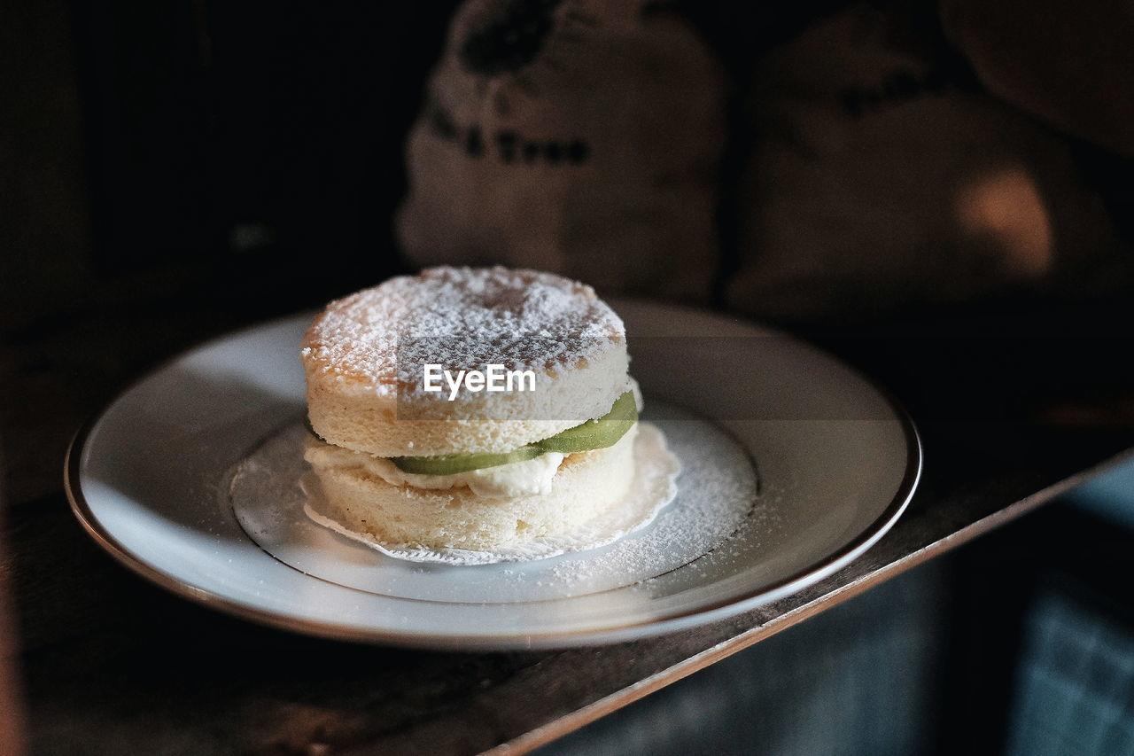 food and drink, food, freshness, sweet food, plate, ready-to-eat, indoors, dessert, sweet, indulgence, table, close-up, temptation, still life, unhealthy eating, no people, cake, focus on foreground, serving size, baked, powdered sugar, crockery, breakfast