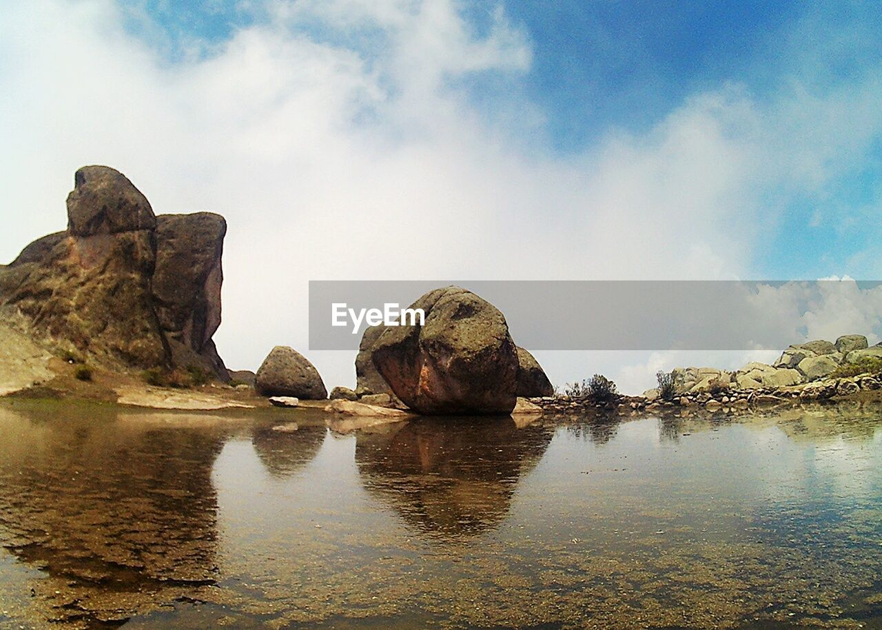 rock - object, sky, rock formation, tranquil scene, tranquility, geology, nature, cloud - sky, rock, beauty in nature, reflection, outdoors, sea, scenics, water, no people, day, physical geography, beach