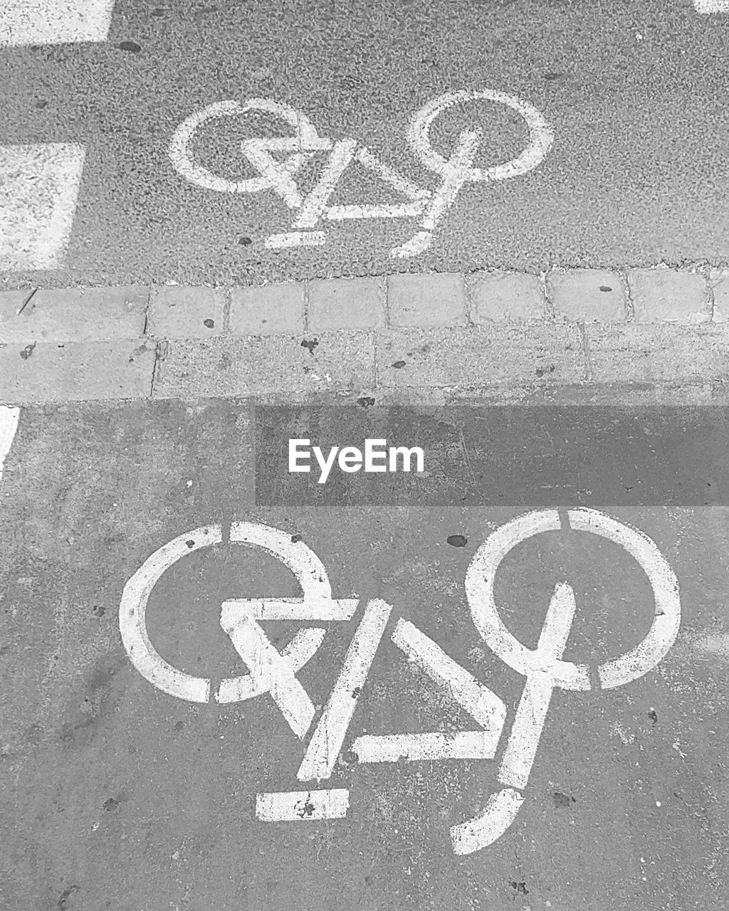 communication, sign, road, text, marking, symbol, road marking, bicycle lane, western script, guidance, high angle view, no people, capital letter, day, city, information, transportation, road sign, street, information sign, message