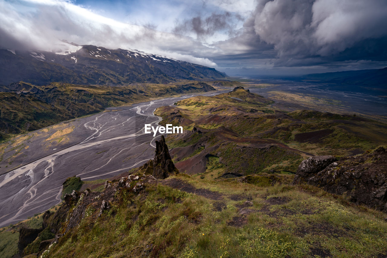 Dramatic clouds coming to the valley of thorsmork, southern iceland. view from valahnukur hill.