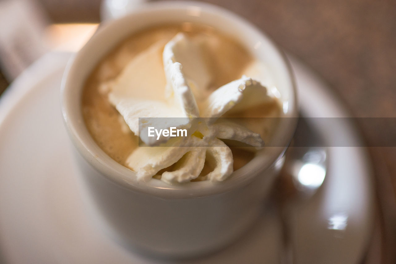Close-Up Of Whipped Cream In Coffee On Table