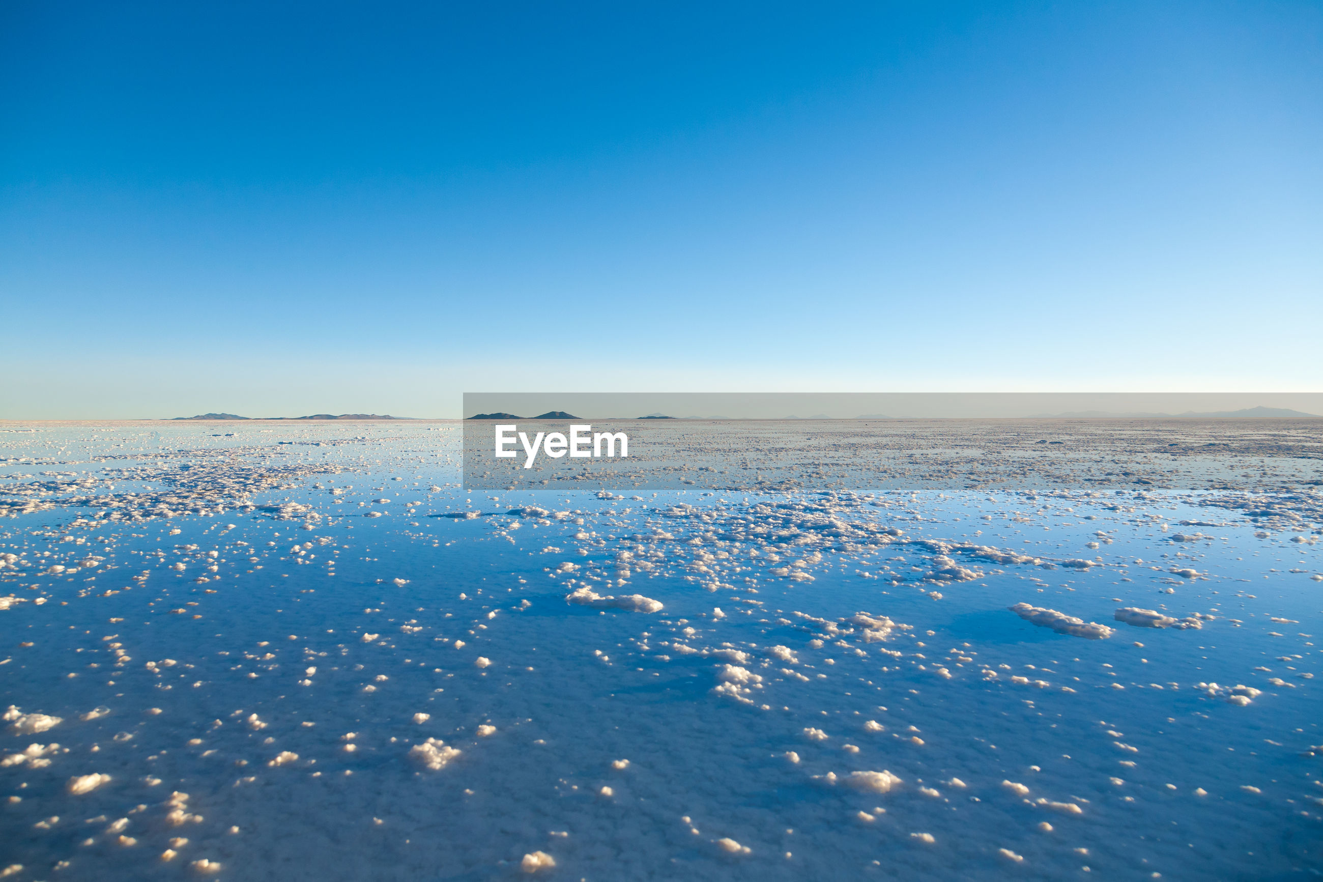 SCENIC VIEW OF SNOW AGAINST CLEAR BLUE SKY