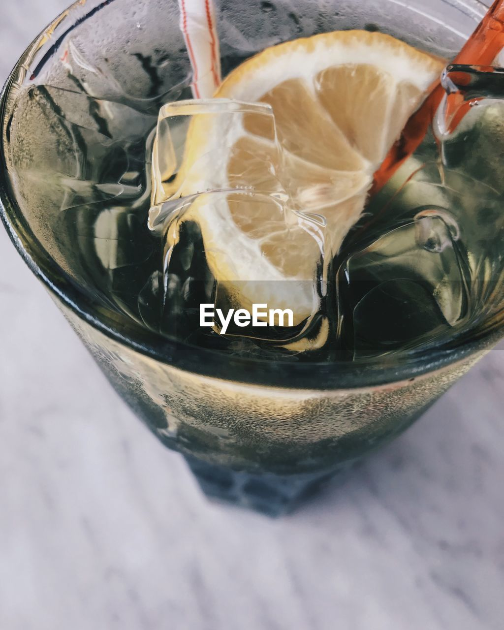 food and drink, drink, refreshment, glass, drinking glass, freshness, food, cold temperature, close-up, frozen, straw, ice cube, table, drinking straw, household equipment, indoors, still life, no people, glass - material, healthy eating, herb
