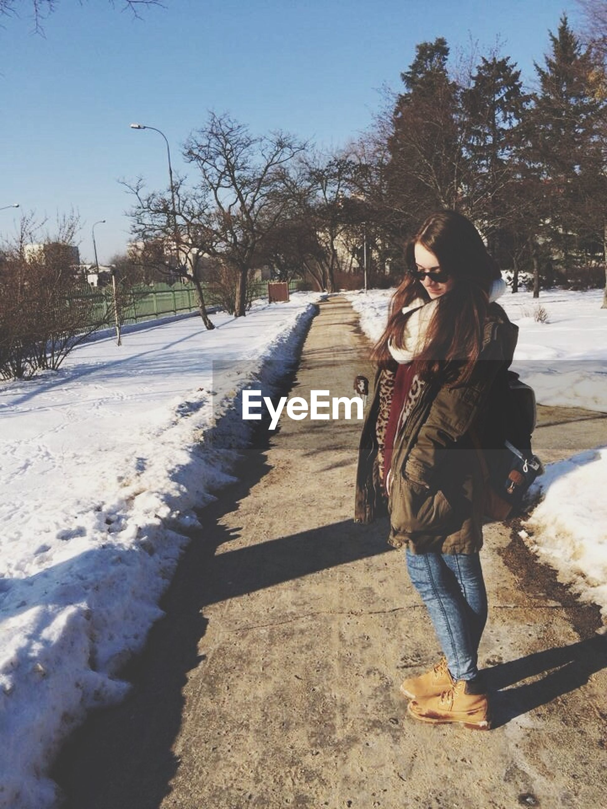 full length, lifestyles, casual clothing, leisure activity, person, tree, childhood, winter, warm clothing, elementary age, rear view, the way forward, standing, day, cold temperature, girls, outdoors, front view