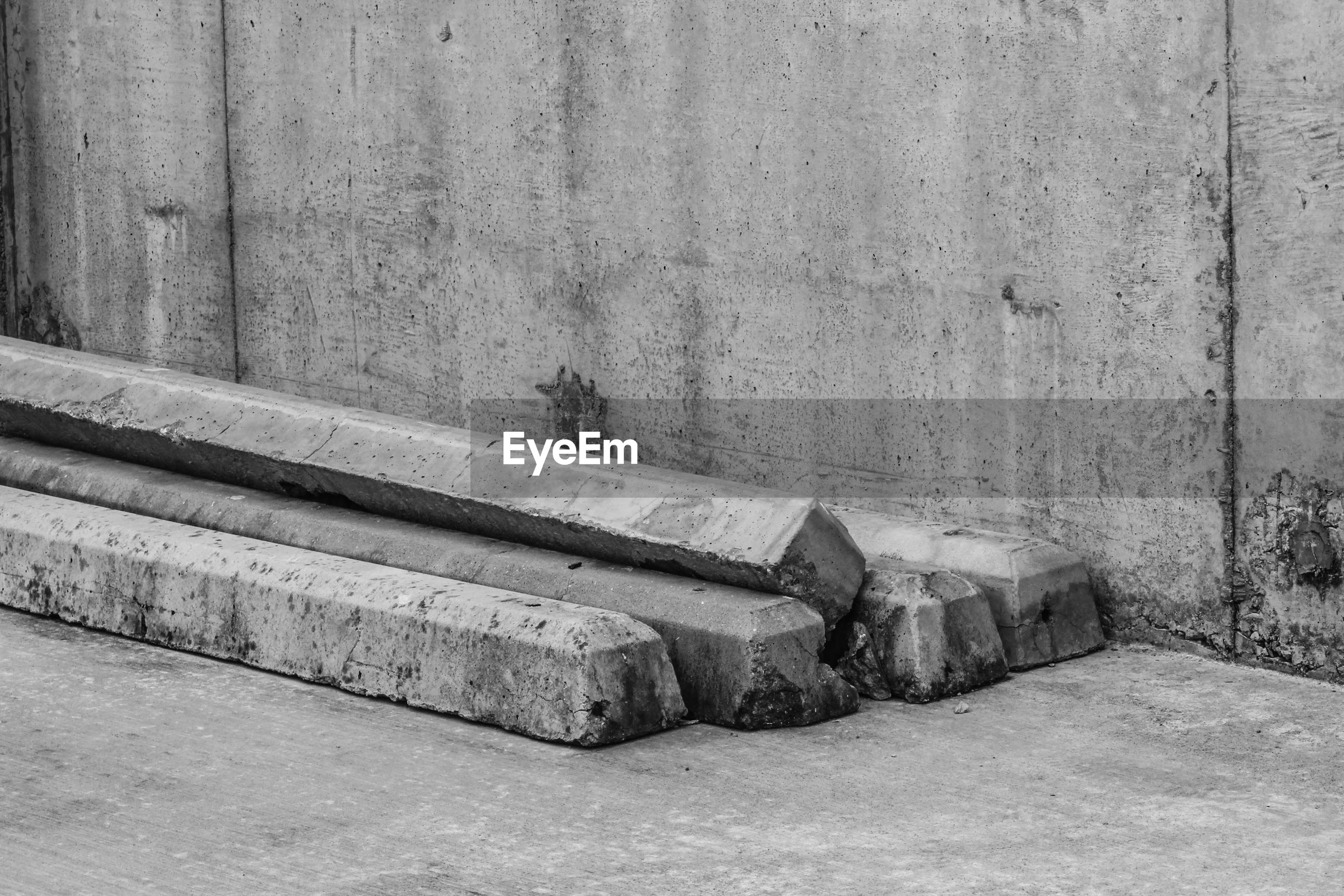 High angle view of abandoned concrete railroad ties against wall
