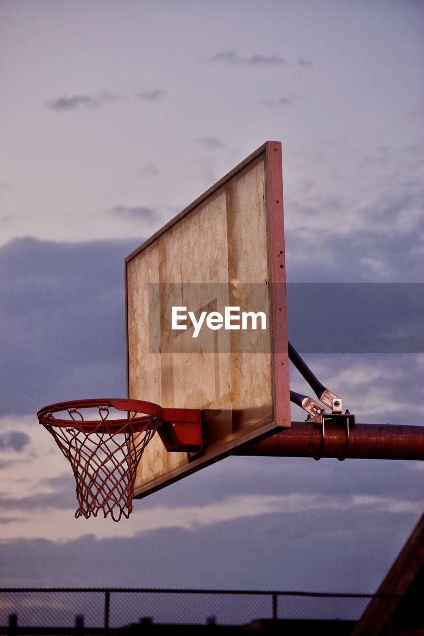 sky, cloud - sky, nature, no people, outdoors, day, metal, basketball hoop, low angle view, water, focus on foreground, sunset, architecture, built structure, basketball - sport, sport, security, rusty, wood - material